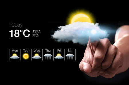 Photo pour Hand pressing virtual weather icon. Weather forecasting is the application of science and technology to predict the state of the atmosphere for a given location. - image libre de droit