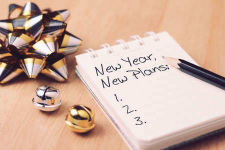 Foto de New year new plan with decoration. Discover how setting goals can bring more happiness in your life. - Imagen libre de derechos
