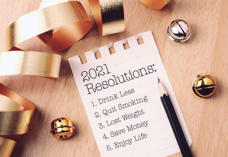Photo pour Resolutions 2021 with beautiful decoration. Discover how setting goals can bring more happiness in your life. - image libre de droit
