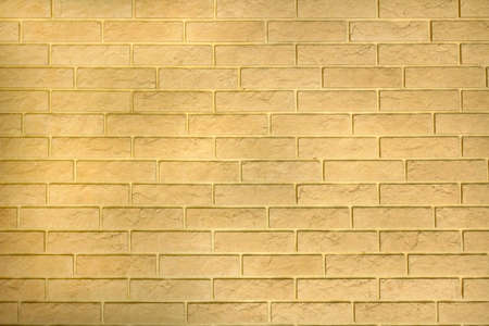 Photo pour Modern yellow background wall texture from decorative bricks. Abstract light masonry surface of building blocks. Simple building in rustic style, rough building house, horizontal architecture wallpaper. - image libre de droit