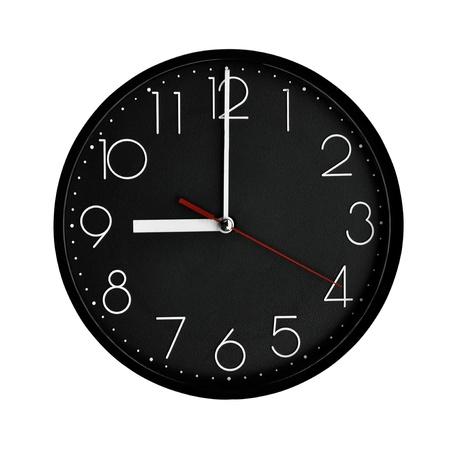 Black clock plastic frame with arabic numerals.