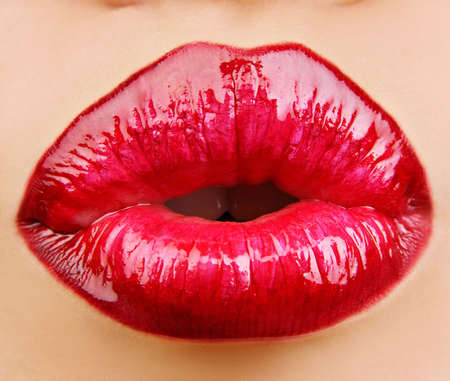 Glamour Red gloss lips with kissing gesture.