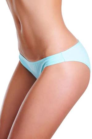 Photo pour Slim and slender female waist and beauty legs. Close-up shot part of a body - image libre de droit