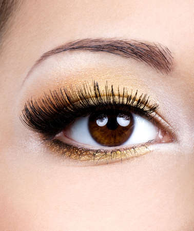 Fashion eye make-up with golden eyeshadow - macro shoot