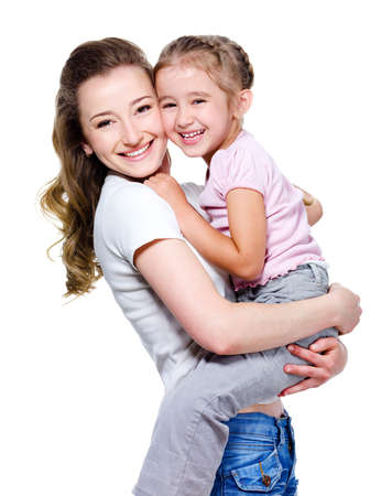 Happy beautiful young mother holding her little cheerful daughter - isolated on white
