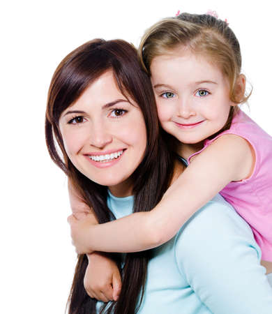 Photo for Happy portrait of beautiful young mother with little pretty daughter - isolated on white - Royalty Free Image