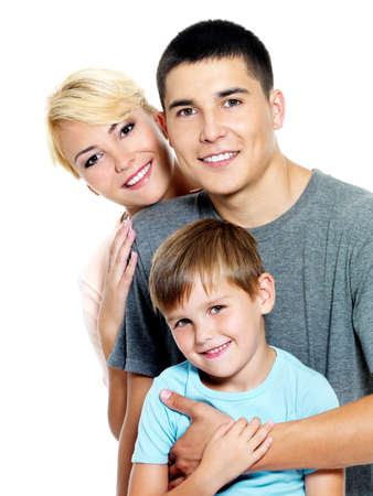 Photo pour Happy young family with son of 6 years posing over white background - image libre de droit