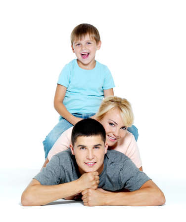 Photo pour Happy young smiling family with little boy  - isolated - image libre de droit