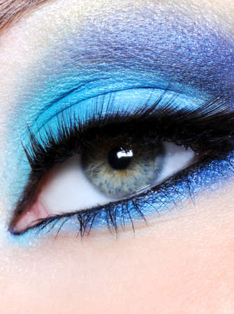 Female eye with bright blue makeup - macro shot