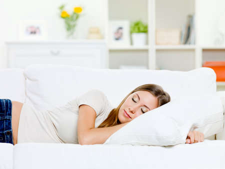 Photo pour beautiful young woman sleeps on a bed in a bedroom at home - image libre de droit
