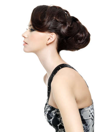 Profile of beautiful brunette young woman with fashion hairstyle - isolated