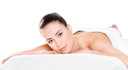 Photo for Beauty woman relaxing on a pillow - white background - Royalty Free Image