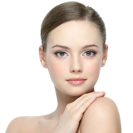 Foto de Portrait of beautiful young girl with clean skin on pretty face - white background - Imagen libre de derechos