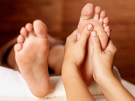 Massage of human foot in spa salon - Soft focus image