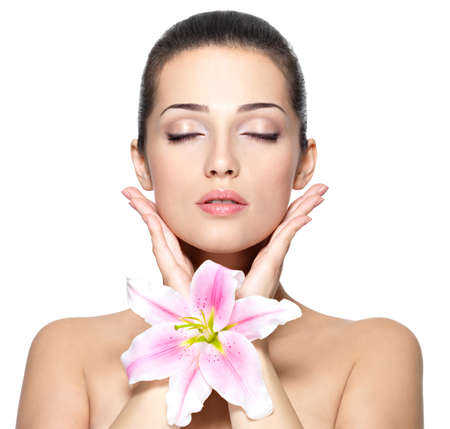 Photo for Beauty face of young woman with flower. Beauty treatment concept. Portrait of young woman with closed eyes - Royalty Free Image
