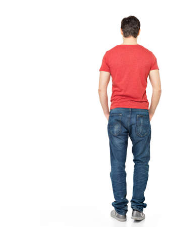 Full portrait of man standing back in casuals - isolated on white background