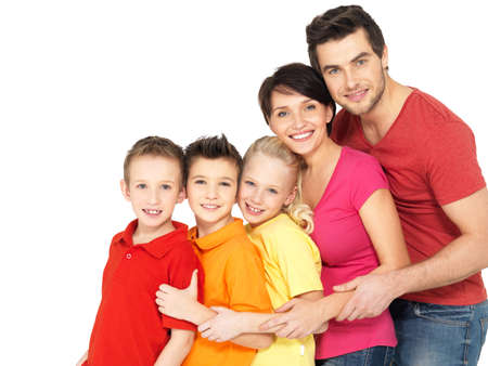 Happy young family with two children standing together in line - isolated on white background