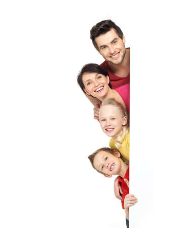Photo for Family with a banner smiling - isolated on a white background - Royalty Free Image