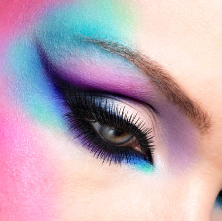 Closeup woman eyes with beautiful  fashion bright blue makeup