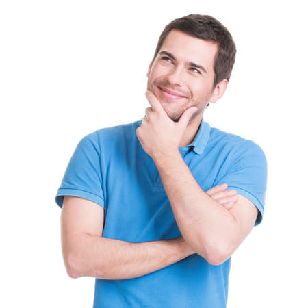 Portrait of the young smiling  thinking man looks up in casuals - isolated on white.