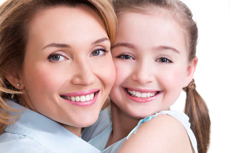 CLoseup portrait of happy  white mother and young daughter - isolated. Happy family people concept.の写真素材