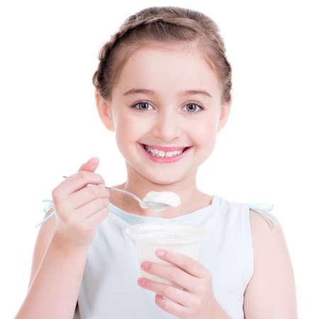 Portrait of a  little girl eating yogurt - isolated on white.