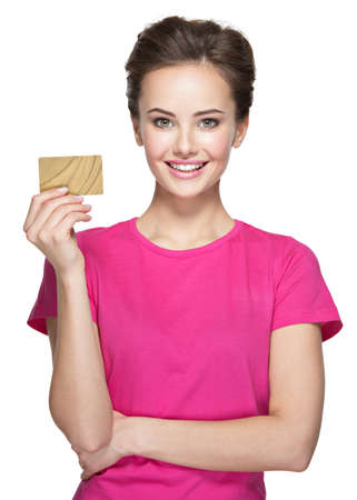 Young smiling woman holds credit card isolated on white