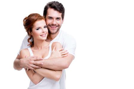 Photo pour Portrait of beautiful smiling couple posing at studio over white background. - image libre de droit