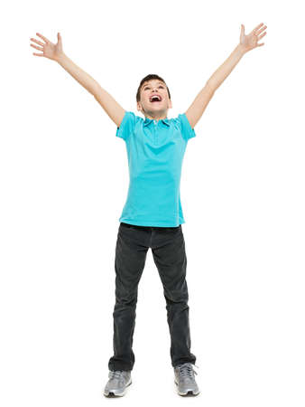 Photo for Young happy teen boy with  in casuals with raised hands up isolated on white background. - Royalty Free Image