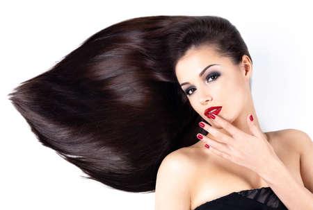 Foto de Beautiful woman with long brown straight hairs and elegance red nails - Imagen libre de derechos