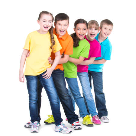 Photo for Group of happy children in colorful t-shirts stand behind each other on white background. - Royalty Free Image