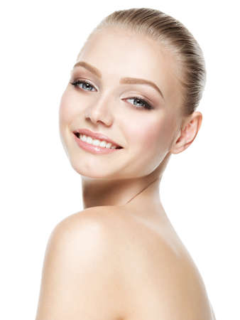 Photo for Beautiful face of young smiling woman with clean fresh skin - isolated on white - Royalty Free Image