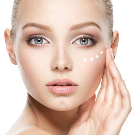 Photo for Young woman with cosmetic  cream on a clean fresh face - Royalty Free Image