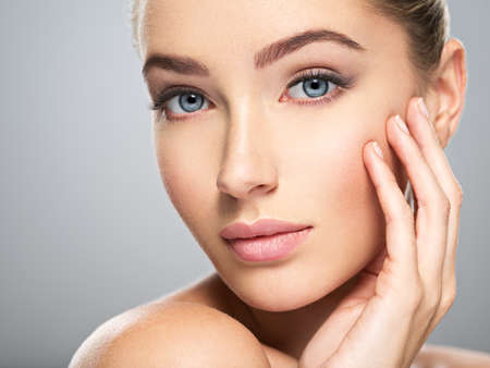 Photo pour Young caucasian woman with beautiful face - isolated on white. Skin care concept. - image libre de droit