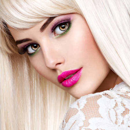 Photo for Portrait of  a  Beautiful  woman with pink make-up and long white straight  hairs.  Face of a Fashion model with pink lipstick. Pretty girl posing at studio. - Royalty Free Image