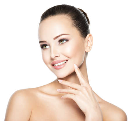 Photo pour Beautiful face of young smiling woman with  health fresh skin - image libre de droit