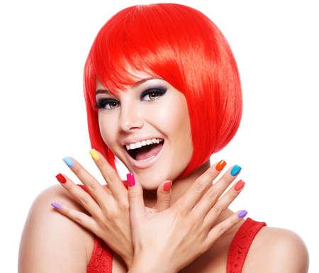 Foto de Close-up face of a fun expressive  girl with bright multicolor nails. Fashion model posing on white background - Imagen libre de derechos