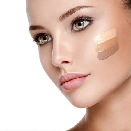 Photo pour Beautiful face of  young woman with cosmetic foundation on a skin.   Beauty treatment concept - image libre de droit
