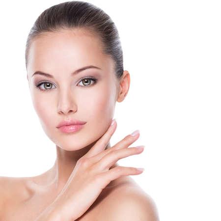 Foto de Closeup portrait of young beautiful woman  with  hands at face - isolated on white background - Imagen libre de derechos