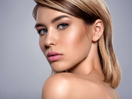 Photo for Close-up portrait of sexy caucasian young woman with beautiful blue eyes. Portrait of beautiful young blond woman with clean face. Attractive model. Beautiful face of young woman with clean skin. - Royalty Free Image