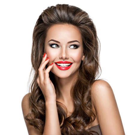 Photo pour Portrait of beautiful woman with long hair poses at studio. Sexy adult girl with red lips and nails. - image libre de droit