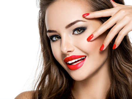 Photo for Closeup face of  beautiful smiling woman with red nails and lips isolated on white - Royalty Free Image
