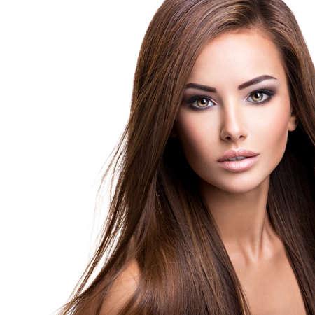 Photo pour Portrait of a beautiful young woman with long straight hair. Fashion model posing at studio. - image libre de droit
