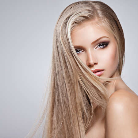 Photo for Pretty  face of young woman with long white hair - posing at studio over gray background - Royalty Free Image