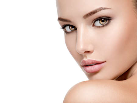 Photo pour Beautiful face of young caucasian woman with perfect health fresh skin  - isolated on white.  Skin care concept. - image libre de droit