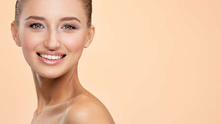 Photo pour Beautiful face of young smiling woman with clean fresh skin - isolated on white - image libre de droit
