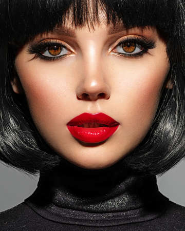 Photo for Beautiful brunette girl with red lips and black bob hairstyle. Pretty young woman with black hair. Closeup portrait of a model with bright makeup on a face. Fashion portrait of a pretty lady. - Royalty Free Image