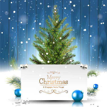 Christmas greeting card with Christmas tree on wooden background