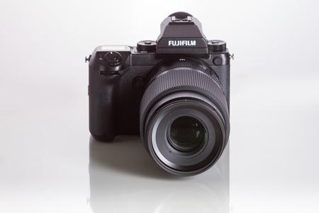 Fujifilm GFX 50S, 51 megapixels, medium format sensor digital camera on white reflecting background with 100 mm G-mount lens