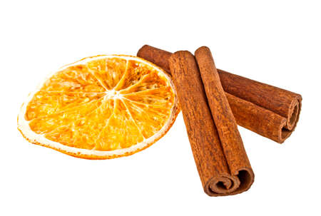 Cinnamon sticks and dried orange slice on a white background